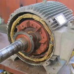What are the common causes of motor shaft wear?